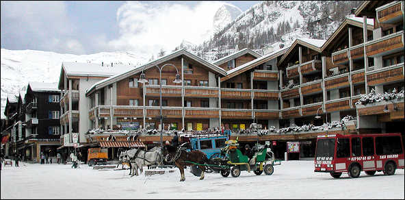 Zermatt taxis - electric vans and horse drawn carriages